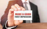 Businessman holding a card with text Make a good first impression - 213791392