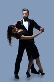 Portrait Of Young Couple Dancing Over Grey Background - 213801511