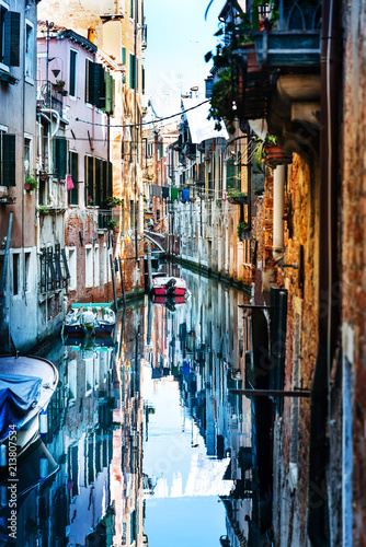Fototapeta VENICE, ITALY - December 21, 2017 : View of water street and old buildings in Venice, ITALY