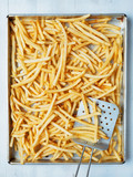 tray of rustic golden french fries - 213813727