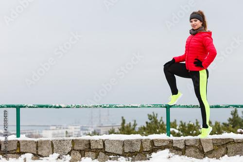 Woman wearing sportswear exercising during winter - 213814119