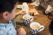 Little Boy Mixing Tea