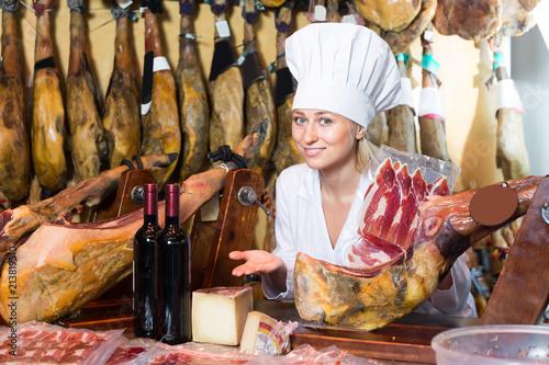 Portrait of happy woman working in meat shop