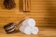 Leinwandbild Motiv Ladle and Towels in Sauna