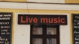 Light board on exterior pub wall with changing text Live Music - 213831354