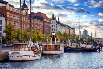 Beautiful cityscape, Helsinki, the capital of Finland, view of the embankment with boats and houses, travel to Northern Europe © olezzo