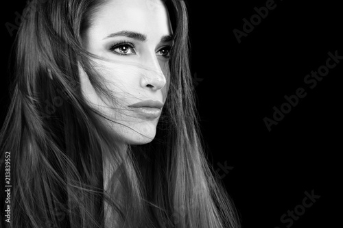 Beautiful young woman with tousled hair style. Healthy long hair © Casther