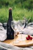 wine bottle with glasses on a wooden board - 213849710