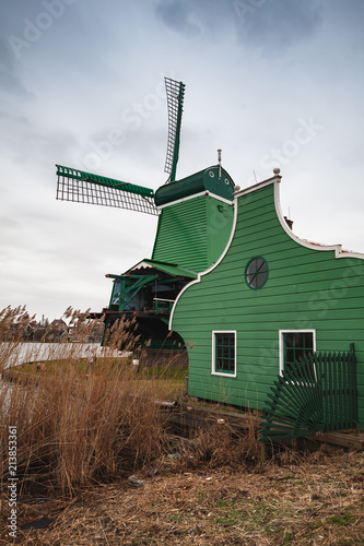 Foto Murales Windmill and green barn on Zaan river coast