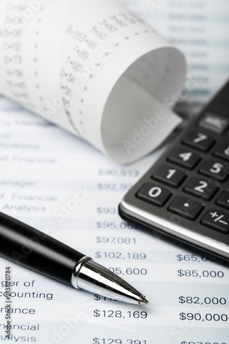 Calculator and Paper Tape with Financial Figures - 213870784