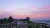 Beautiful view of sunset over arabian city and sea from beach, timelapse - 213882348