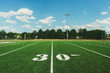 30 Yard Line on American Football Field and blue sky