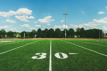30 Yard Line on American Football Field and blue sky