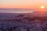 Colorful sunset over Athens, with Acropolis, modern city and Mediterranean Sea, from Lykabetus Hill. - 213893147