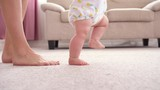 Baby girl walking her first steps - 213902390