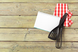 Blank sheet of opened notepad and kitchen utensils on  table with tablecloth, copy space - 213908943