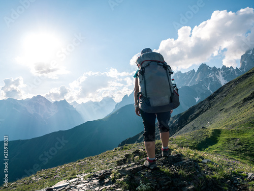 hiking in mountains - 213918321
