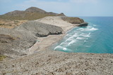 Sandy beach and volcanic rock formation, Playa de Mónsul, Cabo de Gata-Níjar natural park, Mediterranean sea, Almeria, Andalusia, Spain - 213930324