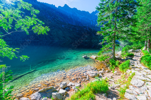 Foto Spatwand Groen blauw transparent turquoise water Sea Eye the lake in the Tatra Mountains, Poland,