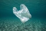 Plastic waste underwater, a plastic bag in the Mediterranean sea between water surface and a sandy seabed, Almeria, Andalusia, Spain - 213943316