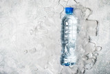 water in bottle on a background of ice. Health detox concept