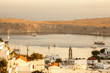 LINDOS, RHODES - OCTOBER 02, 2017: Panoramic views of the city in the rays of the rising sun. Greece