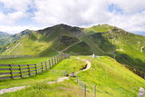 Bikers trail to Schattberg-Ost mountain cable car station, Saalbach-Hinterglemm, Alps, Austria - 213958593