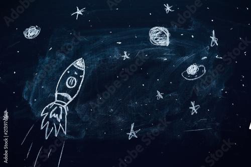 Fototapeta Space rocket doodle drawing on chalkboard
