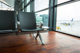 Empty chair on the waiting area of airport terminal - 213990992