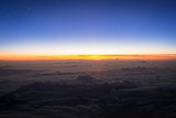 Aerial scenery of sunset over the clouds - 213993340