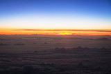 Aerial scenery of sunset over the clouds - 213993374