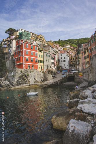 Foto Murales Riomaggiore city, rocky seashore. Cinca Terre. Italy