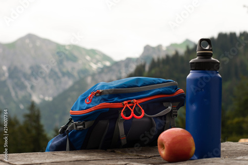 tourist water bottle on the background of mountains