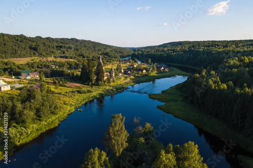 Bird's eye view of the Vazhinka river in Soginicy village, Podporozhysky district. Green forests of Leningrad region and Republic of Karelia, Russia.