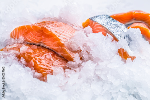 Close-up Fresh raw salmon fillets on Ice - 214037160