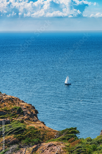 Foto Murales Picture of sea overview with boat on the water and house