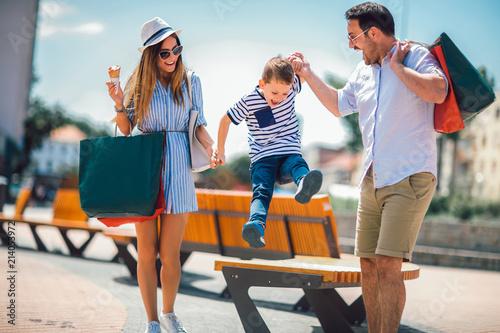 Leinwandbild Motiv Happy family having fun outdoor after shopping