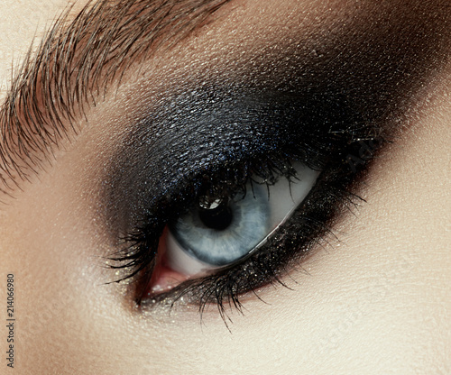 Close up view of young beautiful woman. Perfect skin and evening makeup. Silver smokey eyes. Macro studio shot. Sensuality, passion, cosmetology and modern makeup concept. - 214066980