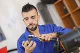 technician cleaning a motor part - 214069501