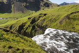 Stunning view of the famous Skogafoss waterfall in southern Iceland on a sunny summer day. - 214080130