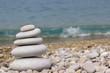 Grey pebbles: stone cairn tower, poise stones,  zen sculpture.