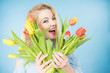 Pretty woman with red yellow tulips bunch - 214103747