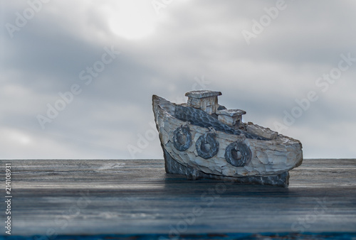 Aluminium Schipbreuk background. white sea boat against the background of a stormy sky. imitation of the sea \ wooden table, painted in blue