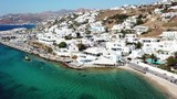 Aerial drone, bird's eye view panoramic video of iconic whitewashed Chora of Mykonos island, Cyclades, Greece - 214114333
