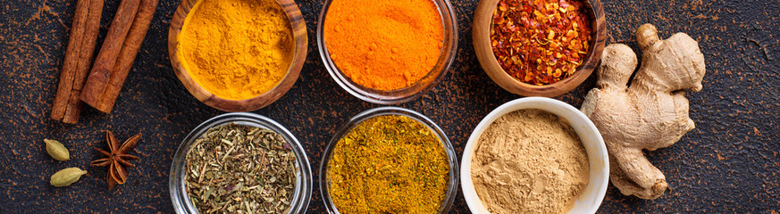Traditional Indian spices on rusty background © Yulia Furman