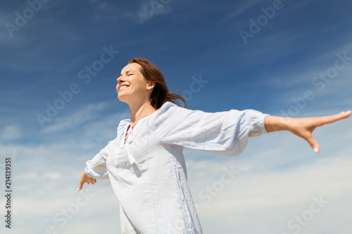 people and leisure concept - happy smiling woman enjoying summer - 214139351
