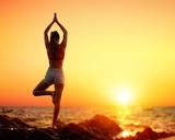 Yoga At Sunset - Girl In Vrikshasana Pose - 214149589
