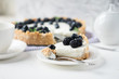 Piece of cheesecake with blueberries and blackberries with white service