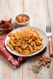 pasta with red pesto, traditional sicilian recipe - 214196540