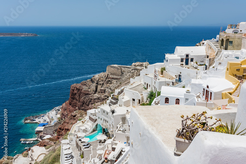 Tiny little white houses, hotels and small churches in the Oia village at Santorini, Greece.